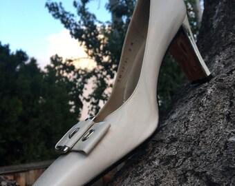 Vintage Stuart Weitzman pump with metallic heel