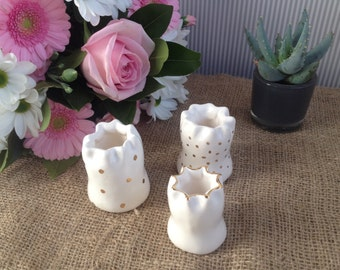 Set of three small handmade white bud vases with 24 carat gold detail.