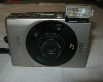 Canon IXUS Canon 24-48 mm f 4.5 62 analogue compact camera for APS film + box, color silver