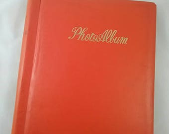 Vintage photo album. Orange mid century album for photos.