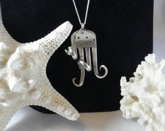 Fun Octopus made from reperpoused, vintage silver plate fork
