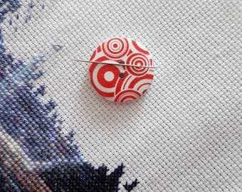 Red circles Needle Minder