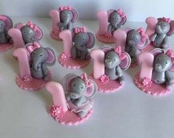 12 elephant with number cupcake toppers made out of fondant