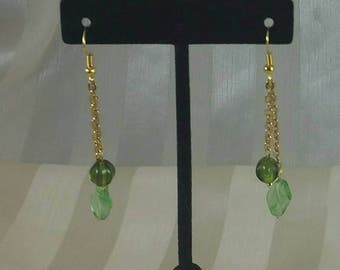 Green beads on gold tone chain