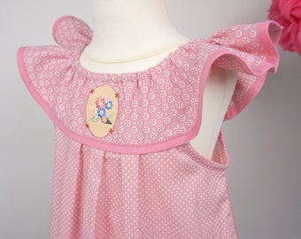 Girls dresses size 110-116 in pink with polka dot and shirred pattern on yoke