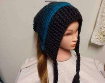 Slouchy hat with braids and pom pom.