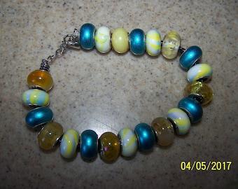 Beautiful Turquoise and Yellow European Style bead charm bracelet on a black leather adjustable bracelet