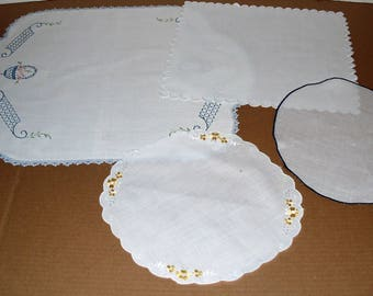 Runners E)  Four Table Runners.  Embroidered.  Square.  Round.  Rectangle.