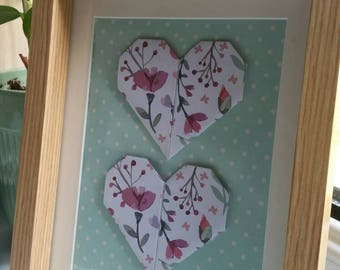 Floral origami hearts in frame.
