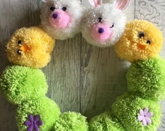 Easter pom pom rabbit and chick green, yellow and white acrylic wool wreath.