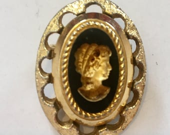 Carved brooch with gold highlights  would look great on a choker