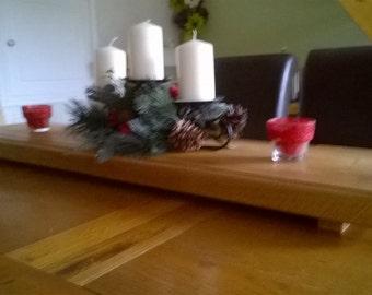 A large raised oak chopping board/table display