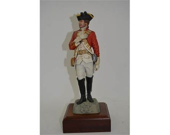 finely detailed model depicting an officer of the British Cavalry atop a rock
