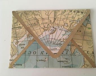 Gold embossed world map envelope