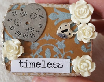 altered tin jewelry box, tiny treasure box, keepsake memory box, pill case, pillbox, miniature trinket box, blue, gold, timeless