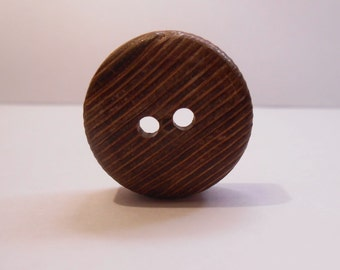 Large wooden button.