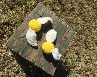 Handmade crochet golden ball with wings