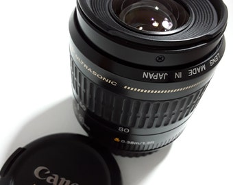 Canon Ultrasonic Zoom Macro lens 35-80mm EF for full frame and crop sensor cameras, complete with both end caps. Made in Japan