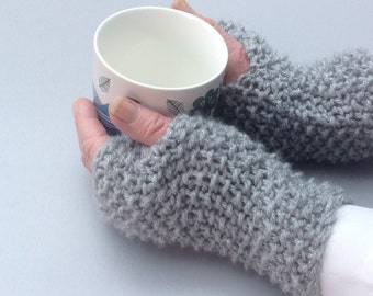 Ladies' hand knitted sparkly pair of wrist warmers/fingerless gloves. Soft, warm and cosy.