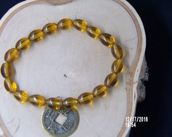 B1275  Amber glass Beaded Bracelet with Chinese good luck charm..