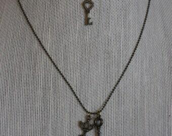 Vintage mini skeleton charm necklace