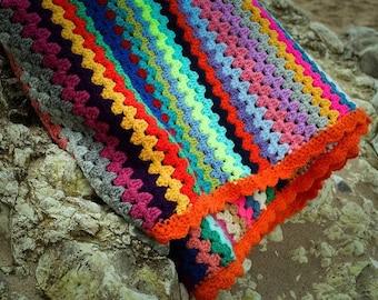 Crocheted granny striped blanket
