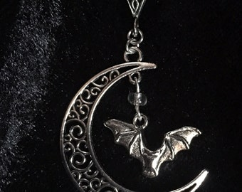 filigree silver pendant of gothic witch witchy moon with bat,