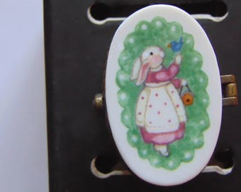 "Dainty lady bunny  by Sue Dreamer for MCF, inside is a painted Blue Bird holding a lily says ""Hello Friend"" with a tiny rabbit trinket"
