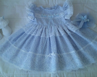 3 Piece oufit in blue with a profusion of lace and ribbon