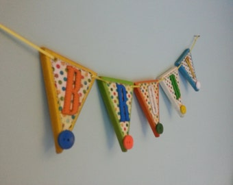 Colourful, spotty personalised MDF name bunting with buttons