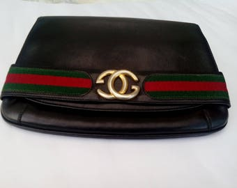 GUCCI clutch vintage black leather clutch 1970's, GUCCI authentic.Excellent condition. Preppy clutch