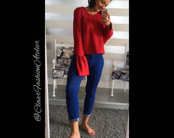 Deep red sweater sleeves bell shaped