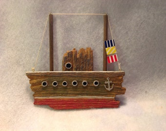 Sail boat made primitively made looks like drift wood
