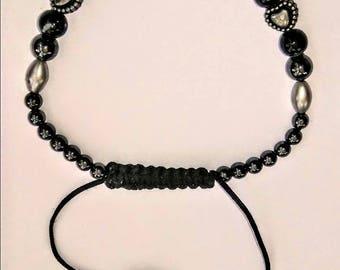 Adjustable beaded black bracelet.