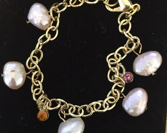 Gold chain bracelet with pink freshwater pearls and dangling gems