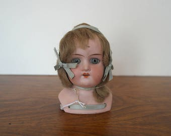 German Bisque Porcelain Doll with Mohair Hair and Ribbons