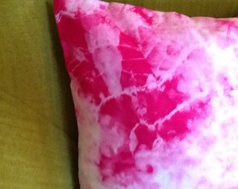 Bright pink tie-dyed cushion cover / pillow.