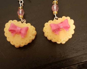 Pink and yellow bow love heart cake earrings