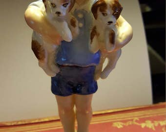 Royal Worcester Mondays Child boy with puppies figurine made in England.
