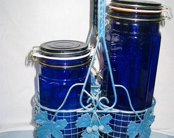Set of  2 Cobalt Blue Canisters with decorative wire caddy.