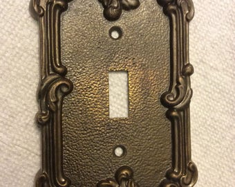 Vintage brass switch plate cover. Burnished brass switch plate cover