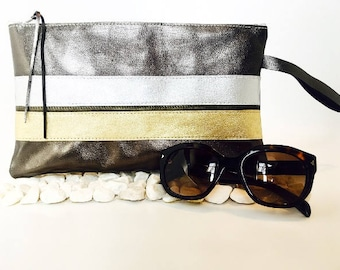 Lined linen shiny leather pouch