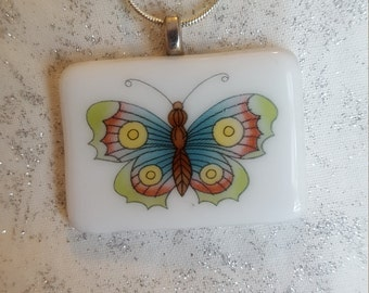 Dichroic glass pendant with butterfly and silver chain