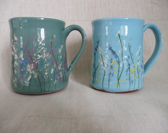 Handmade pottery mugs with a spring flower design