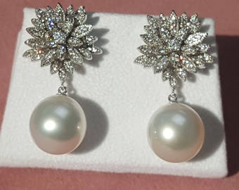 South Sea Pearl Earrings, 13mm, AAA quality, Oval shape, 18K setting with 0.98ct SI2 Diamonds.