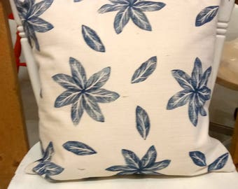 Hand-printed cushion with leaf and flower motif
