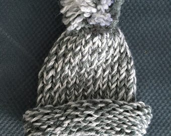 Knitted baby hat with pom pom