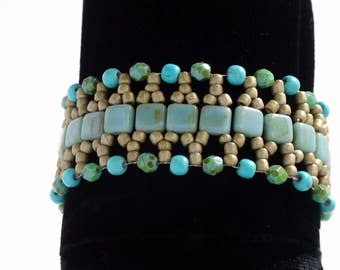 Turquoise green and gold hand beaded bracelet