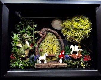 Welcome to fairy land a shadow box with a fairy door,magic dragon with crystal Spector,a unicorn and pegasus