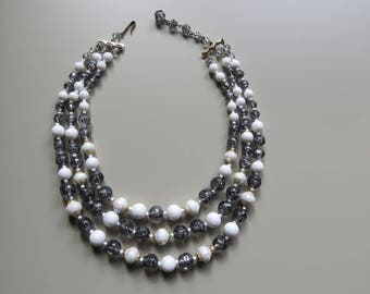 Stylish, vintage black and white three strand bead necklace.